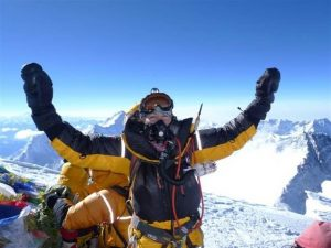 "MANDY RAMSDEN AT THE TOP OF MOUNT EVEREST (Photo from the HSZ talk ""Climbing the Highest Mountain on each of the Seven Continents"" by Mandy Ramsden)."