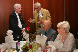 WWI BARBED WIRE TABLE DECORATION AT THE HSZ 2018 ANNUAL LUNCHEON BILL WOODMAN TALKS TO ROBIN TAYLOR (Photo - Benny Leon)